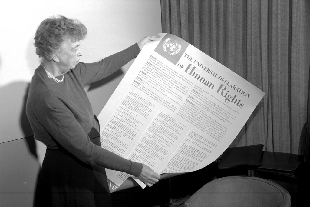 Eleanor Roosevelt of the United States holding a Declaration of Human Rights poster in English. (November 1949). UN Photo
