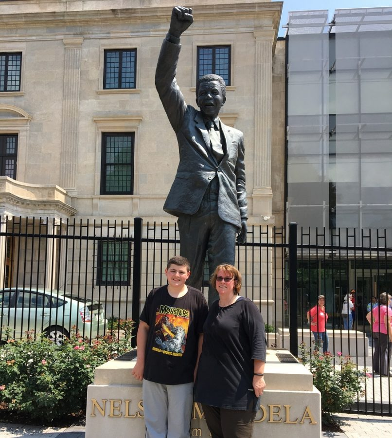 My son Scott and me outside the South African Embassy on Mandela Day.