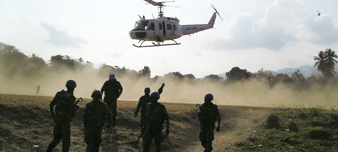 UN peacekeepers fly into a town to perform emergency surgery on wounded Haitian police officers.