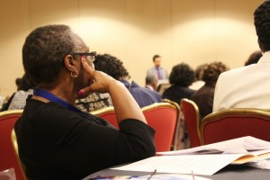 Participant of the 28th Annual AME Conference listening to speaker Felipe Munevar